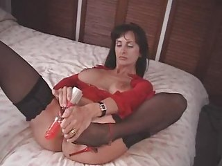 british milf copulates herself with a pair of