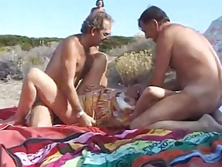 fully dressed fuck on the beach