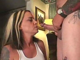 charming milf engulfing the schlong of a tattooed