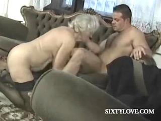 older blonde slut rides cock in group sex
