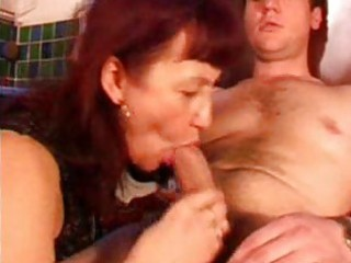 mature redhead with black stockings sucks cock in