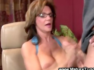 mature lady massaging a ramrod