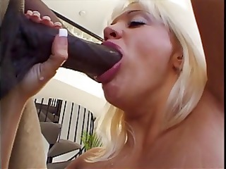 blonde mouth drains a giant black cock