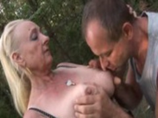 german granny is drilled in the forest by a