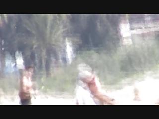 flashing jock to granny in the beach