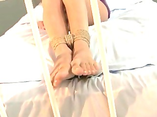 tied to a bed by her mistress!!!!!!!
