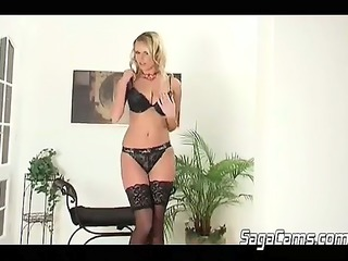 blond with huge boobs stripping in